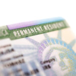 How much does it cost to hire an immigration lawyer to get a green card?